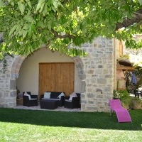 Relax under the shade of the 13th century arch